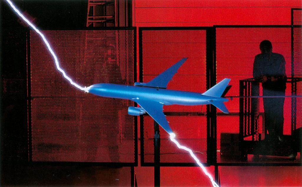 Scale model airplane passing artificial lightning discharge