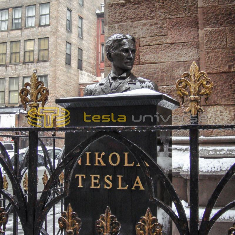 The Tesla statue at St. Sava Cathedral showing Tesla's name in gold